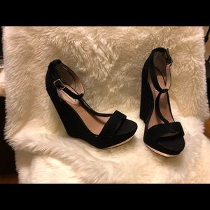 Steve Madden Xtrime black wedges with gold trim.